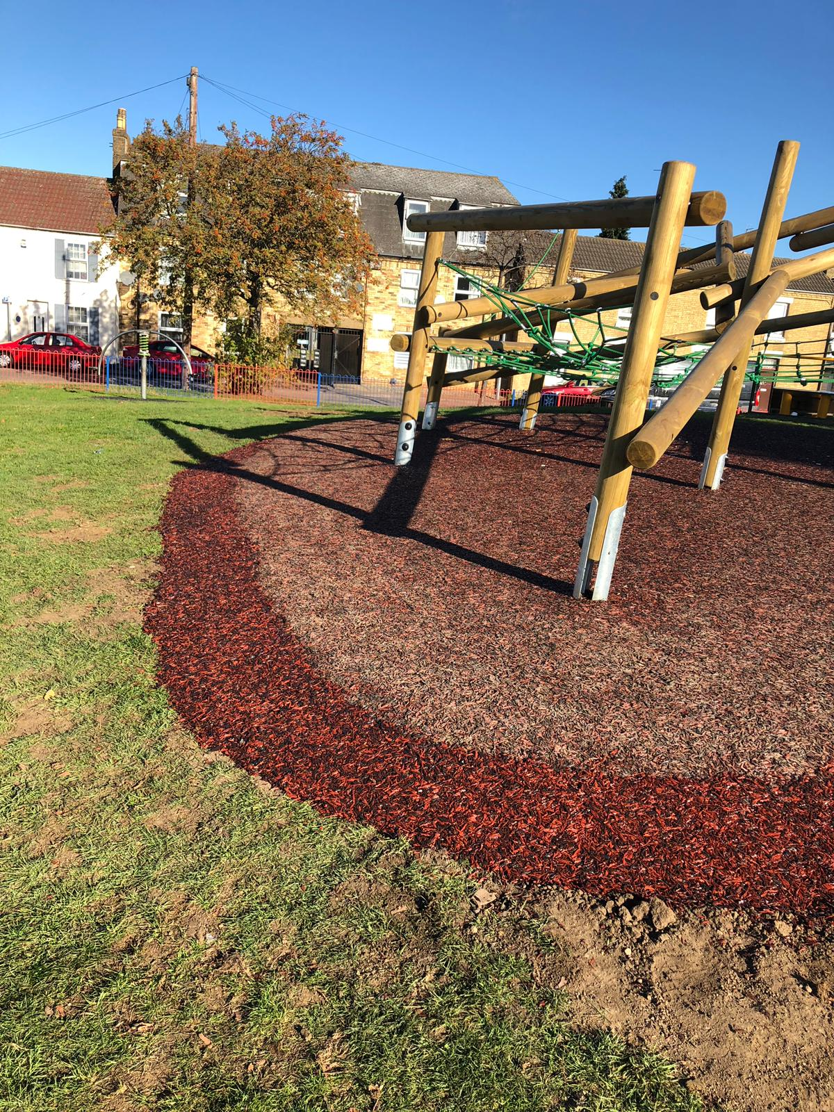 rubber mulch with wooden play equipment